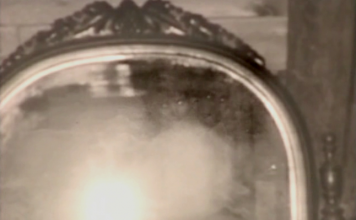 Unexplained faces captured by the crew can be seen top right of mirror.